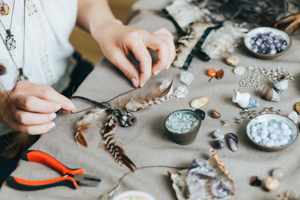 Woman hands making handmade jewelry